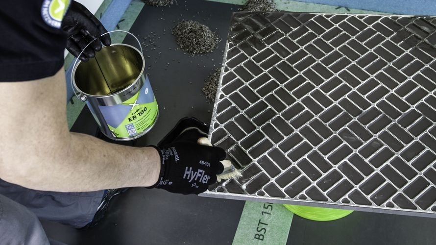 Prime the tile back with ER 100 to ensure better adhesion.